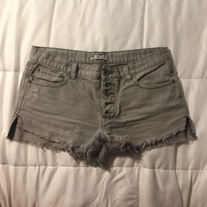 Free People Mid Rise Grey button up jean shorts.